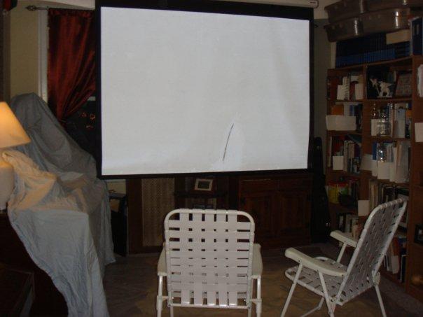 beach chairs, sand, huge screen
