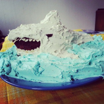 3D chocolate cake with a lot of blue and white icing in form of a shark