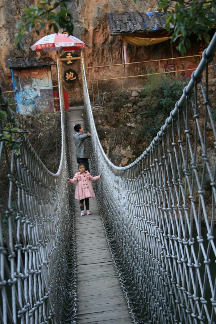 Little Girl owning the hanging bridge
